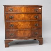 A 20th Century reproduction Regency style low chest of four long drawers having brass drop handles