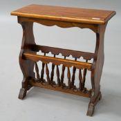A modern hardwood magazine table having spindle under rack and floor protectors on feet