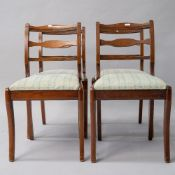 A set of four stained frame reproduction Regency style dining chairs having jade green upholstery
