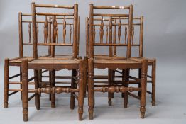 A (harlequin) set of six 19th Century spindle back chairs having solid elm seats , triple spindle to