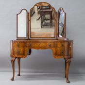 An early to mid 20th Century burr walnut dressing table , of kidney shaped design having triple