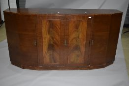 An early to mid 20th Century sapele sideboard having stepped design, with central double cupboard