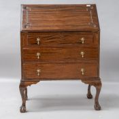 A traditional stained frame bureau , carved and cockbeaded detailing to flap , three drawers to base