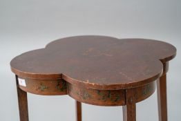 A 19th Century occasional table having shaped top and undertier, both having transfer decoration, on