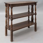 An early 20th Century oak etage/bookshelf having shaped ends and turned frame, width approx 69cm