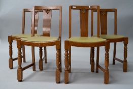 A set of four mid 20th Century oak and ply dining chairs, havingbent ply backs, lime green vinyl