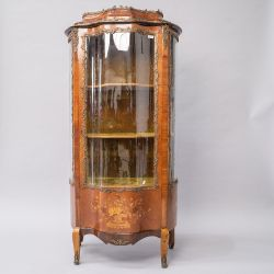 A Louis XV kingswood vitrine display cabinet having shaped glass front and side panels, typical