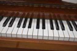 A modern upright piano , inlaid Zender, in polished mahogany case being overstrung, width approx.