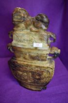 A large and imposing archaic styled Chinese sop stone lidded vessel having dragon head handles