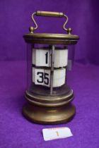 A 1930's desktop flip ticket clock by Ever Ready the Chronos Clock having glass and brass case