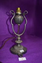 A 1920's electric travel lamp possibly train or boat related having a moving gimble