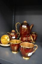 A part tea service by Carlton ware in the rouge royale design serving six