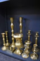 Three sets of brass cast candle sticks also and anchor styled cnadle stick and two mantle urns