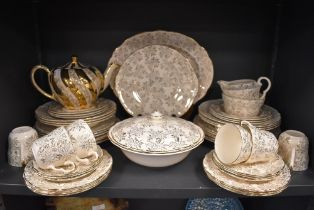 A part dinner and tea service by Washington Pottery, Hanley, in a cream ground a gilt design