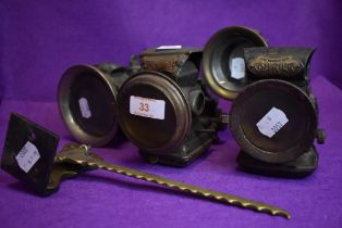 Four early 20th century motor or cycle lamps including Courier, H Miller and Lucas