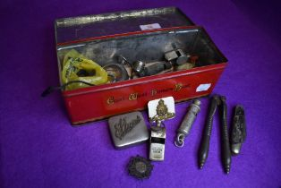 A selection of hardware including whistles pocket and pen knives and similar items