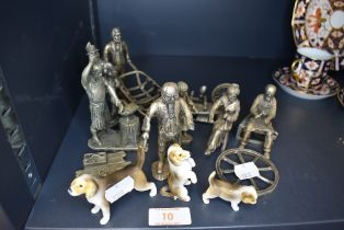 A selection of both metal cast and ceramic figures including small dogs