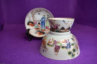 A New Hall tea bowl and saucer depicting scenes of child catchi
