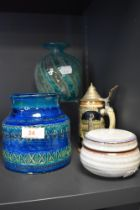 A studio pottery vase having green and blue glaze marked Italy to base and a squat twist design vase