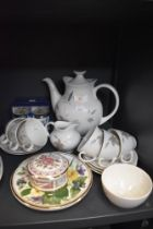 A part tea service by Royal Doulton in the Tumbling Leaves design and similar
