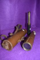 A four drawer brass cased telescope by Brittanic BC and Co having fitted leather case and a