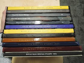A collection of 12 Royal Mail Special Stamps Year Books 1984-1995, 1-12, all appear complete