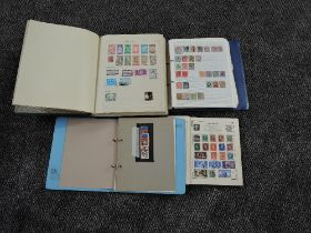 A collection of GB & World Stamps in four albums , mint & used