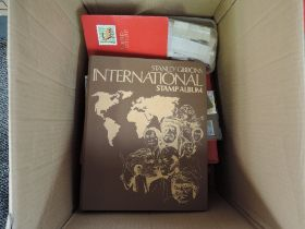 A box of GB and World Stamps, loose, in stock books and albums along with a small collection of