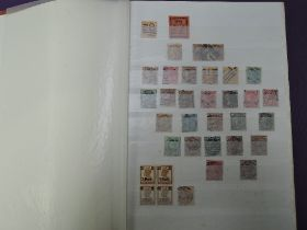 A stock book of India and Indian states Stamps, mint and used