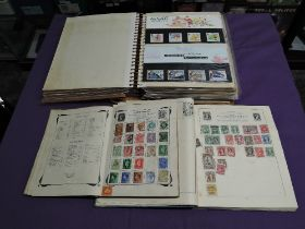 An album of mainly GB Presentation Packs along with two World Stamp Albums
