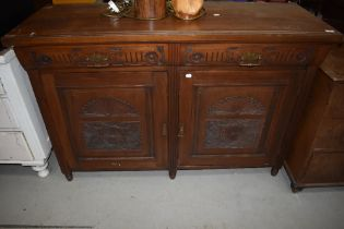 A late 19th Century mahogany sideboard base, having Aesthetic style brass handles, width approx.