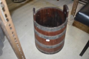 A vintage oak and metal bound milking pail