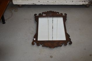 A 19th Century Chippendale style mahogany frame wall mirror