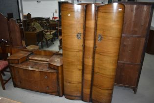 A mid 20th Century walnut ply wardrobe and dressing table