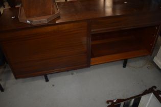 A vintage sapele sideboard (office or living) having tambour doors, width approx 153cm