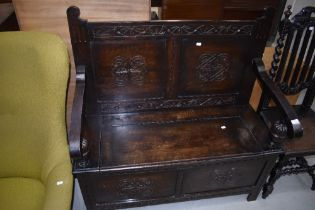 An early 20th Century oak carved box settle , labelled internally for J Snowden and Co, Morecambe
