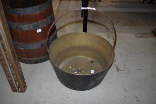 A traditional brass jam pan