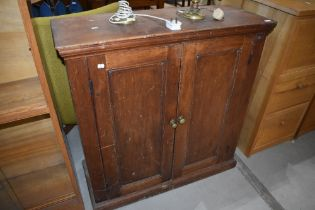 A 19th Century red stained pine shallow cabinet, having shelved interior, approx dimensions W100 D39