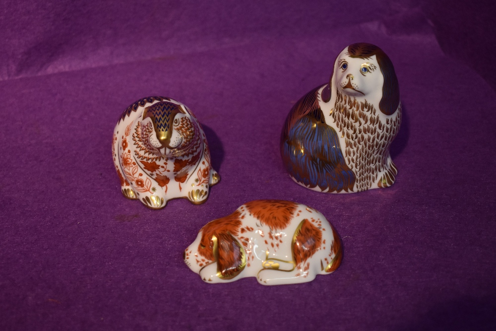 Three Royal Crown Derby Paperweights, King Charles Spaniel, Beaver and Collector's Guild Puppy,