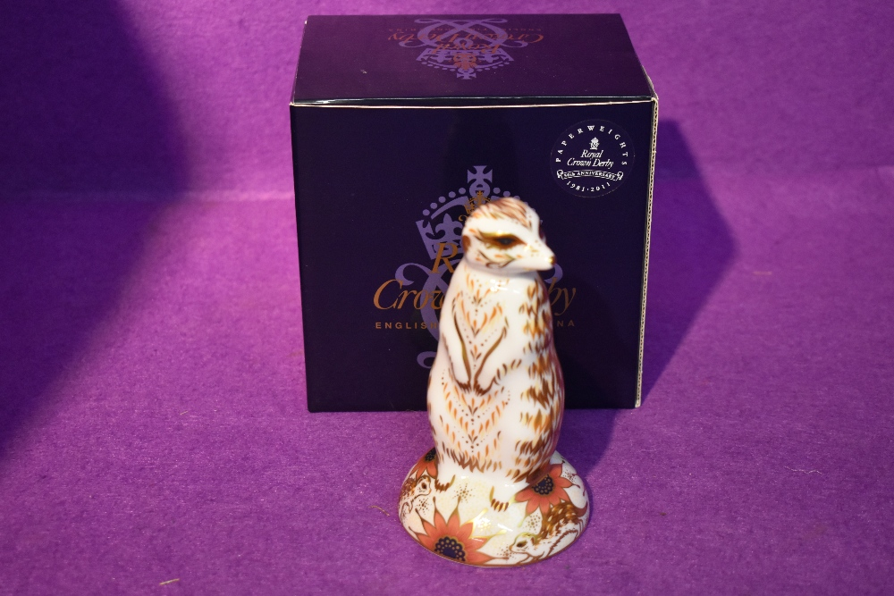 A Royal Crown Derby Paperweight, Meerkat, with original gold stopper and boxed