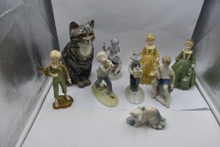 A selection of decorative Studies and Figurines, a Winstanley Cat, Metzler & Ortloff Children at
