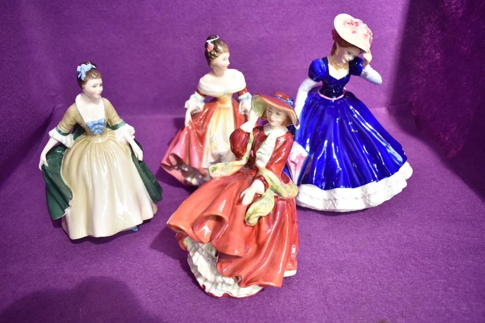 Four Royal Doulton figures, Elegance HN2264, Southern Belle HN2229, Top O The Hill HN1834 and Figure