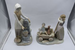 A Lladro study, The Cart, Girl with Cart holding boy and dog, model no 1245 and a Nao study, Girl