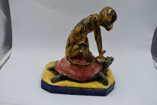 A reproduction Majolika style study, Monkey riding Turtle on ceramic base