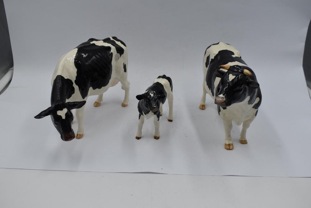 Three modern ceramic Border Fine Arts Studies, Friesian Bull, Friesian Cow and Friesian Calf
