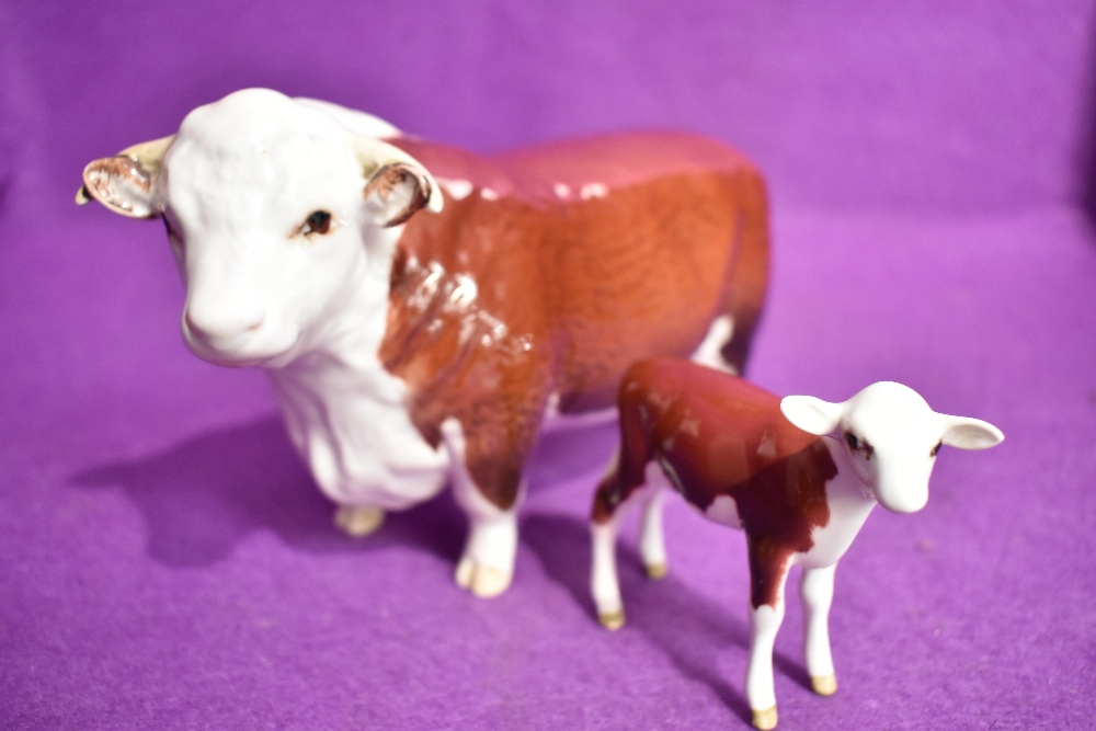 Two Beswick figure studies, Hereford Bull 1363A 1st version, and Hereford Calf 1249E