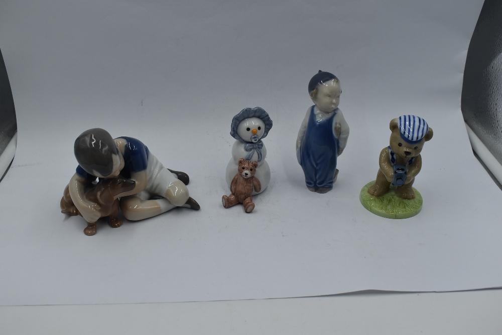 Three Royal Copenhagen figures, Boy with Dog 1502, Boy 3250 and Snow Baby with Teddy Bear 019