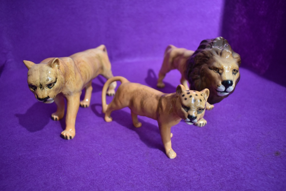 A first version set of figure studies the Lion Family by Beswick, Lion 1506, Lioness 1507 and Lion