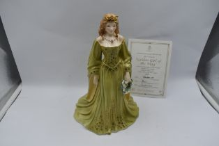 A Royal Worcester Compton & Woodhouse limited edition Figurine, The Golden Girl Of May 527/7500 with