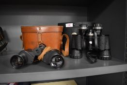 Two pairs of vintage binoculars including Boots 8x40 and Beck Kassel 8x30